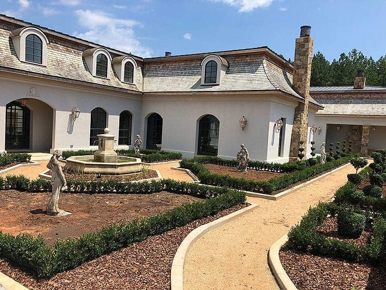 Boxwood for sale. An estate in North Carolina used Green Mountain Buxus InstantHedge to create this classic French Provincial look.